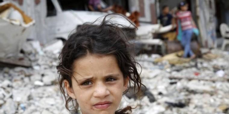 little girl in war ruins