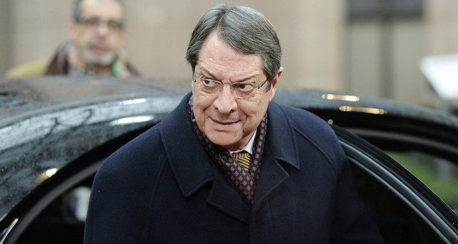 The President of Cyprus Nicos Anastasiades arrives for an EU leaders summit with Turkey on migrants crisis on March 7, 2016 at the European Council, in Brussels. European Union leaders will on March 7 back closing down the Balkans route used by most migrants to reach Europe, diplomats said, after at least 25 more people drowned trying to cross the Aegean Sea en route to Greece. The declaration drafted by EU ambassadors on March 6 will be announced at a summit in Brussels on March 7, set to also be attended by Turkish Prime Minister Ahmet Davutoglu. / AFP / THIERRY CHARLIER