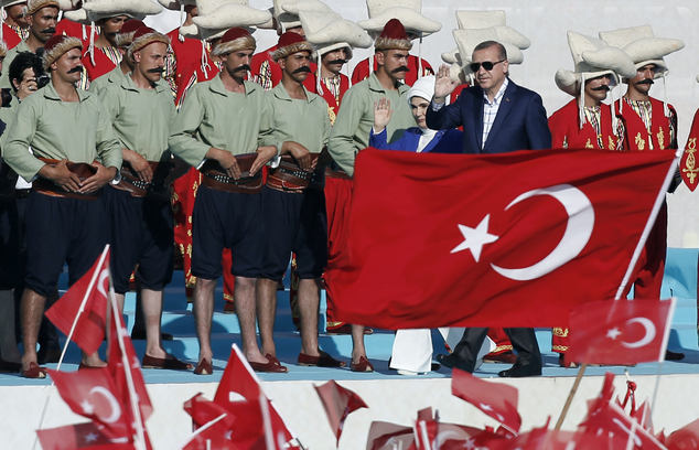 Turkey's President Recep Tayyip Erdogan and his wife Emine Erdogan wave as they arrive to attend ceremonies marking the 563rd anniversary of the conquest of the city by Ottoman Turks, in Istanbul, Turkey, Sunday, May 29, 2016. (AP Photo/Emrah Gurel)
