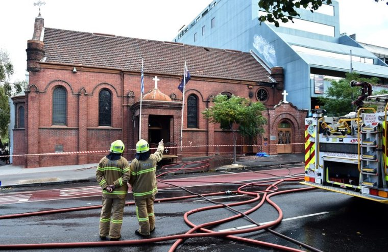 Firefighters survey the scene of a fire at the Annunciation of Our Lady Greek Orthodox Church in Melbourne, Australia, 02 May 2016. According to reports, some 200 people were evacuated from nearby buildings during the incident. The fire was under control within an hour, media added. EPA/JULIAN SMITH AUSTRALIA AND NEW ZEALAND OUT