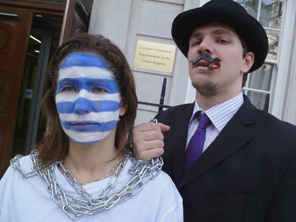 Campaigners from Jubilee Debt Campaign UK dressed as bankers hold Greece in chains outside the European Commission in London to demand debt cancellation for Greece not bailouts for banks, 20 February 2012. © Jubilee Debt Campaign, tel +44 (0)20 7324 4722, media@jubileedebtcampaign.org.uk