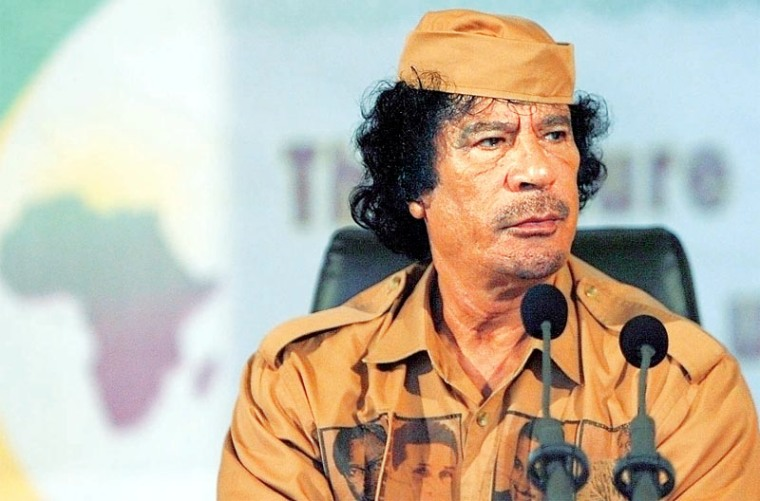 "Libyan leader Muammar Gaddafi speaks at the University of Ghana in Accra June 30, 2007. Declaring himself a ""soldier for Africa"", Gaddafi called on the continent on Saturday to unite under a single government so it could compete in a globalised world. REUTERS/Luc Gnago (GHANA)"