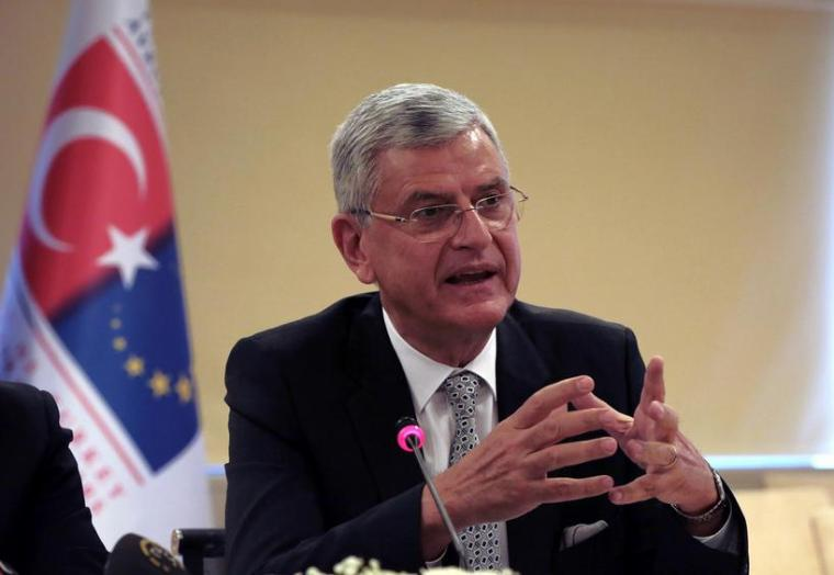 "Turkey's EU Affairs Minister Volkan Bozkir speaks during a news conference with Foreign Minister Mevlut Cavusoglu in Ankara, Turkey, Wednesday, May 4, 2016. Turkey has hailed the European Union executive Commission's recommendation to grant Turkish citizens the right to travel to Europe without visas as ""a new page"" in relations between Turkey and the EU. Cavusoglu said Wednesday's announcement brings Turkish citizens closer than ever to visa-free travel to Europe.(AP Photo/Burhan Ozbilici)"
