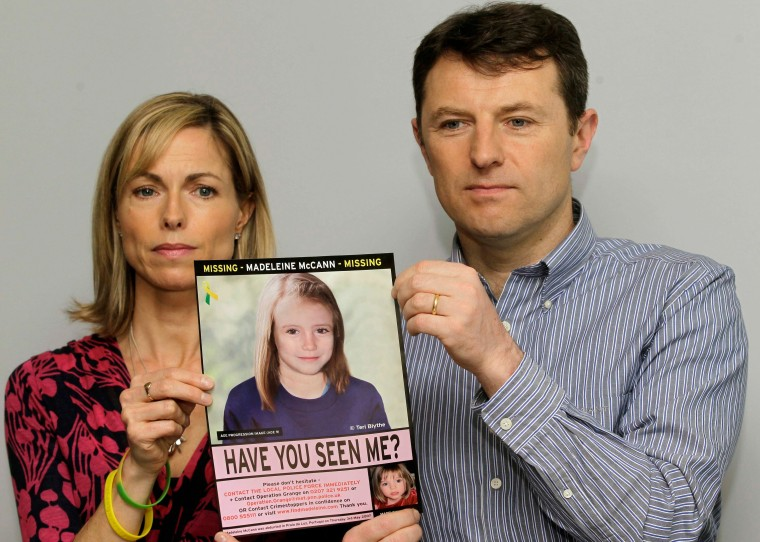 Kate and Gerry McCann pose with a missing poster of their daughter Madeleine as talk to the media in London Wednesday, May 2, 2012 to mark their daughter Madeleine's birthday and the 5th anniversary of their daughter disappearance during a family vacation in southern Portugal in May 2007 shortly before her fourth birthday. (AP Photo/Sang Tan)