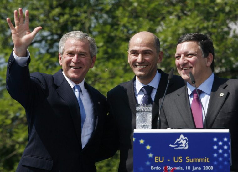 US President George W. Bush, left,  waves at the end of the press conference with Slovenian Prime Minister Janez Jansa, center and  European Union Commission President Jose Manuel Barroso, following EU-US talks in Brdo castle, Slovenia, Tuesday, June 10, 2008.