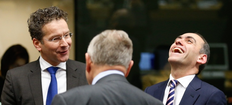 Cypriot Minister of Finance Harris Georgiades (R) with Dutch Finance Minister and President of the Eurogroup Jeroen Dijsselbloem