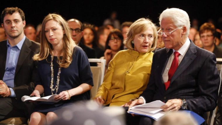 Hillary Rodham Clinton speaks with former U. S. President Bill Clinton (R) as their daughter Chelsea sits with her husband Marc Mezvinsky