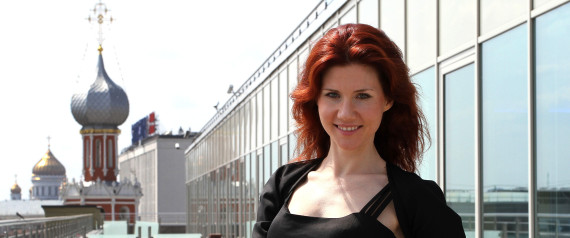 """Anna Chapman, the former Russian spy, poses for a photograph against the Moscow skyline following an interview at an office in Moscow, Russia, on Friday, June 3, 2011. """"I've always been fascinated with technology,"""" Chapman, 29, said in an interview in Bloomberg via Getty Images News' Moscow office yesterday. Photographer: Andrey Rudakov/Bloomberg via Getty Images"""