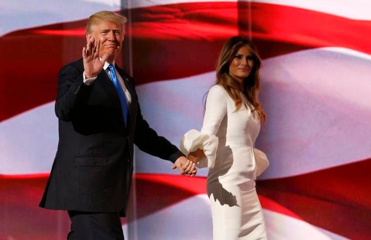 epa05431374 Donald Trump (L) escorts his wife Melania (R) after her speech during the second session on the first day of the 2016 Republican National Convention at Quicken Loans Arena in Cleveland, Ohio, USA, 18 July 2016. The four-day convention is expected to end with Donald Trump formally accepting the nomination of the Republican Party as their presidential candidate in the 2016 election.  EPA/MICHAEL REYNOLDS