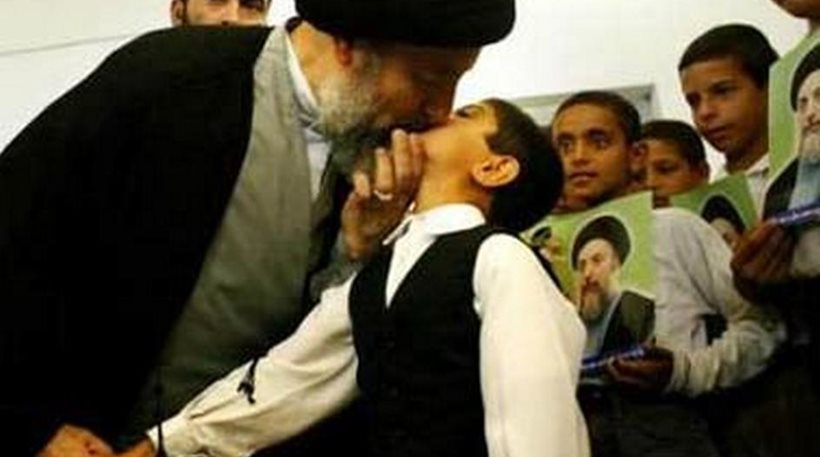 imam kissing boy on mouth