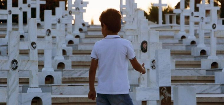 A child visits the graves of Greek and Cypriot soldiers killed in the 1974 Turkish invasion of Cyprus, at the Tymvos Macedonitissas military cemetery in Nicosia, Cyprus.