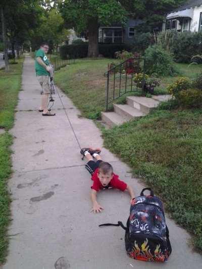 draging-boy-to-school