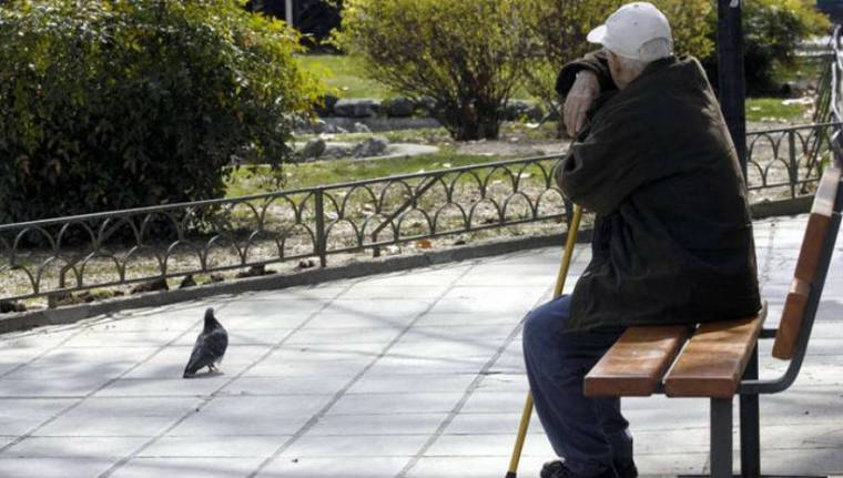 Greek pensioner in park