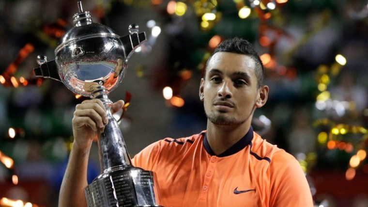 Nick Kyrgios of Australia holds up his trophy after winning the men's singles final match against David Goffin of Belgium at the Japan Open Tennis Championships in Tokyo, Japan, 09 October 2016.