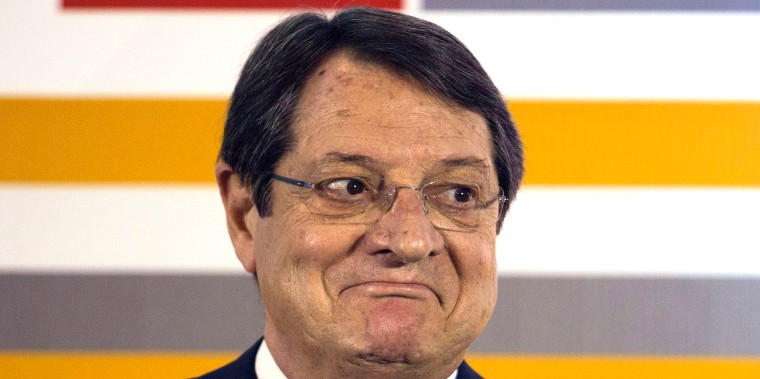 Nicos Anastasiades, Cyprus's president, reacts during the Ninth Cyprus Summit in Nicosia, Cyprus, on Monday, Nov. 25, 2013. Cyprus interest repayments and budget deficit in 2014 mean that the country would need more severe budget cuts without bailout accord, Georgiades said today. Photographer: Andrew Caballero-Reynolds/Bloomberg *** Local Caption *** Nicos Anastasiades