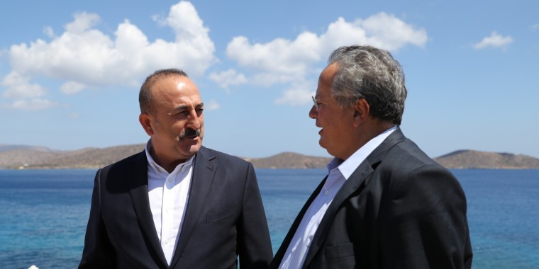 CRETE, GREECE - AUGUST 28: Turkish Foreign Minister Mevlut Cavusoglu (L) speaks with his Greek counterpart Nikos Kotzias (R) during his unofficial visit in Crete, Greece on August 28, 2016. (Photo by Fatih Aktas/Anadolu Agency/Getty Images)