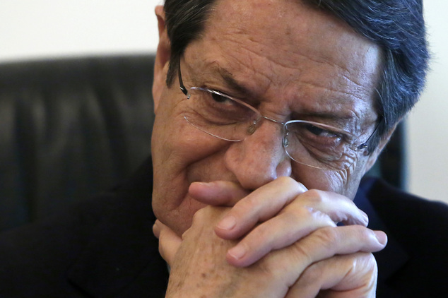 Cyprus' President Nicos Anastasiades speaks to the Associated Press during an interview at his office in the presidential palace in capital Nicosia in this divided Mediterranean island of Cyprus, Friday, Jan. 15, 2016. Cyprus' president says talks aimed at reunifying the ethnically divided Mediterranean island could conclude in a peace deal this year. (AP Photo/Petros Karadjias)
