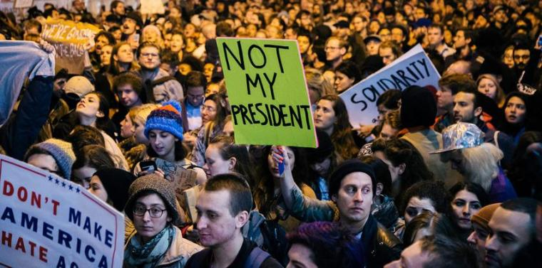 People participate in a protest against the election of Donald Trump as President of the United States in New York, New York, USA, 09 November 2016. President-elect Donald Trump will become the 45th President of the United States of America to serve from 2017.