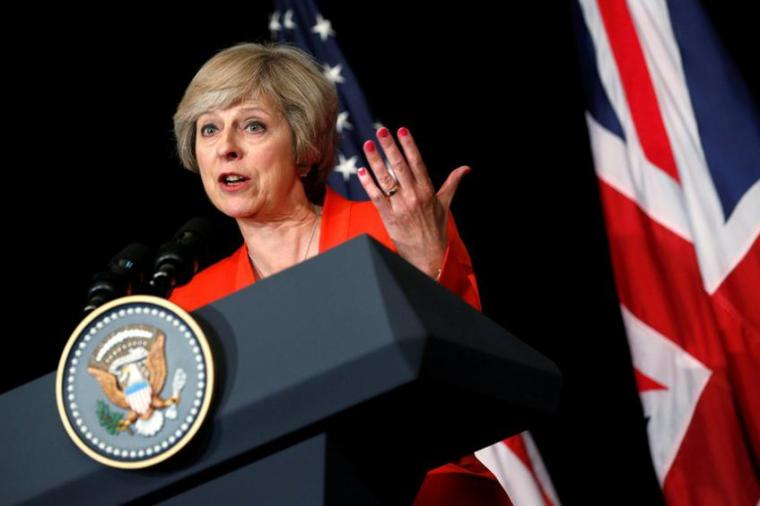 Britain's Prime Minister Theresa May answers a reporter's question after a bilateral meeting with U.S. President Barack Obama.