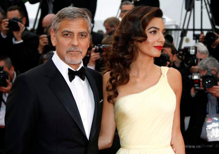 US actor George Clooney (L) and wife British human rights barrister Amal Clooney (R) arrive for the screening of 'Money Monster' during the 69th annual Cannes Film Festival, in Cannes, France, 12 May 2016.