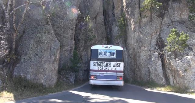 bus-through-narrow-rock