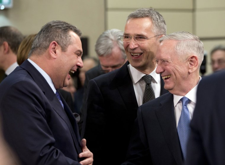 U.S. Secretary of Defense Jim Mattis, right, and NATO Secretary General Jens Stoltenberg, second right, greet Greek Defense Minister Panos Kammenos, left, during a meeting of the North Atlantic Council at NATO headquarters in Brussels on Wednesday, Feb. 15, 2017. For U.S. Defense Secretary Jim Mattis, the next few days will be a reassurance tour with a twist. He is expected to tell allies the U.S. is committed to NATO and is also hoping to secure bigger defense spending commitments. (AP Photo/Virginia Mayo)