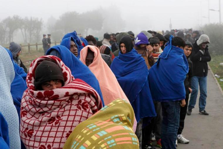 """Migrants queue on the third day of their evacuation and transfer to reception centers in France, as part of the dismantlement of the camp called the """"Jungle"""" in Calais, France, October 26, 2016.  REUTERS/Philippe Wojazer"""