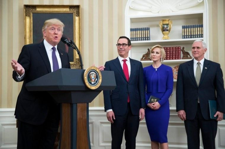 President Donald J. Trump (L), while accompanied by US Vice President Mike Pence (R), Secretary of Treasury nominee Steven Mnuchin (2-L) and Mnuchin's fiancee Louise Linton.
